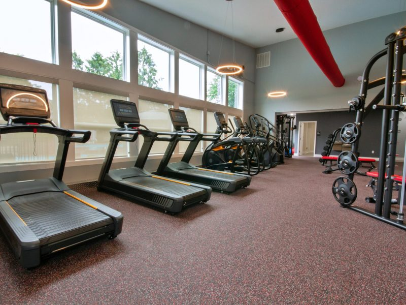 View showing treadmills facing the windows along with stair steppers and other workout equipment