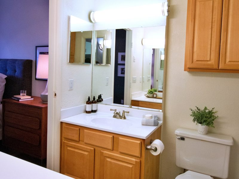 This image features an upgraded bathroom with clean countertops and modern brushed nickel fixtures.