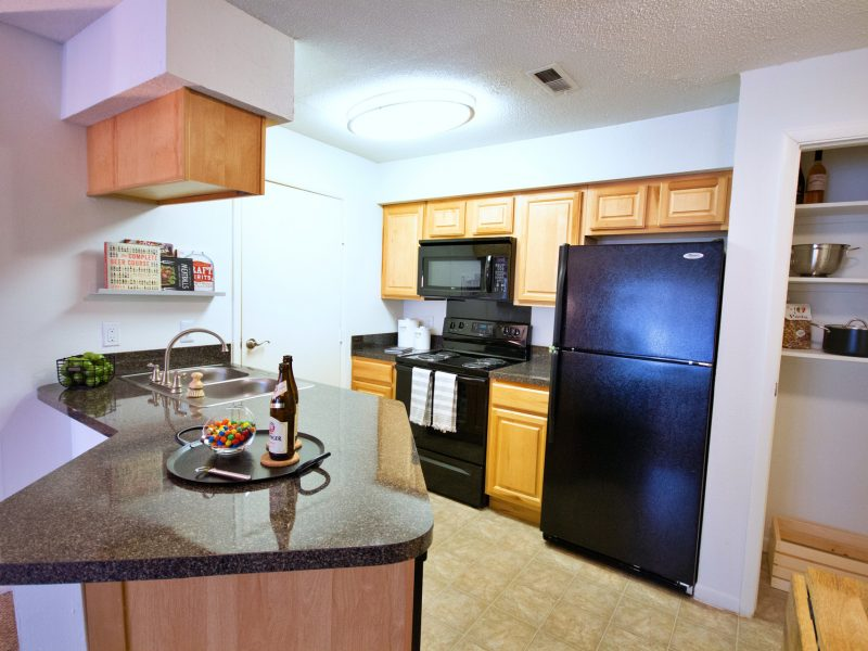 This image exhibits the premium apartment feature, particularly the kitchen island featuring a newly renovated kitchen with high-end details, a breakfast bar, and ceramic tile throughout the foyer.